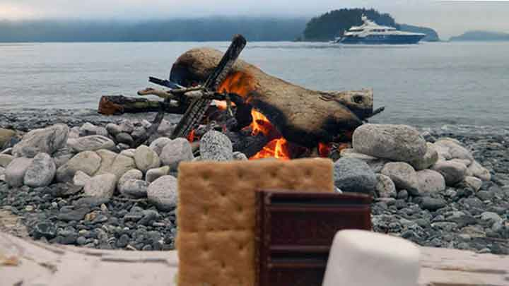 a southeast Alaska yacht charter via megayacht can involve a beach s'mores party