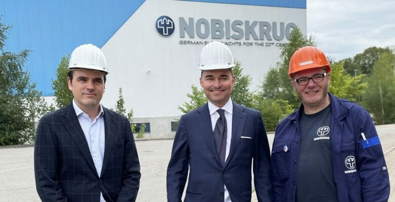 Philipp Maracke, Lars Windhorst, and Marcus Stöcken are pleased with the Nobiskrug takeover and superyacht operations
